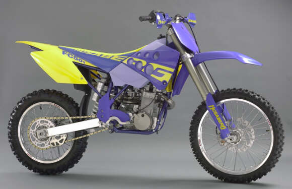 2000 Husaberg FC501><br /><b>2000 Husaberg FC501</div> <p>Do you remember who invented the modern, lightweight, four-stroke motocross bike?  Did you guess Yamaha?  You&#8217;re wrong.  Husaberg did several years before Yamaha introduced its YZ400 in 1998.<br /> <br /> What is Husaberg?  Would you believe a company that was founded by passionate, Swedish engineers, working in a small workshop, designing their machines virtually from scratch, and building them virtually by hand?  Husaberg started this way, and developed its reputation slowly, but solidly by delivering the lightest, highest-performing four-stroke off-road bikes ever seen.  The only thing Yamaha did was bring lightweight four-stroke dirt bike performance to the masses.  The Yamaha is cheaper &#8212; significantly cheaper than a Husaberg FC501.  But the Husaberg was first, and it remains the elite machine in its class.<br /> <br /> Husaberg was purchased by KTM, and now operates as a division of KTM.  Interestingly, KTM appears to be positioning Husaberg as an even higher spec bike than KTM&#8217;s own four-strokes.  Yes, you heard me right, the new Husabergs are even more trick, and lighter than KTM&#8217;s highly anticipated, super-lightweight four-stroke motocrossers and enduros.<br /> <br /> This article focuses on the 2000 Husaberg FC501 (also available as a 600cc model &#8212; the FC600).  This is Husaberg&#8217;s pure motocross model &#8212; the lightest and most nimble Husaberg available in the United States, or any other market for that matter.<br /> <br /> Let&#8217;s start with the claimed weight of the FC501, which is truly remarkable.  First of all, remember that Yamaha&#8217;s YZ400 is exceptionally light for a four-stroke motocross bike.  The new, as yet unreleased, KTM 400SX and 520SX are, according to KTM, ten pounds lighter than the Yamaha.  Also according to KTM (at least its Husaberg division), the Husaberg FC501 is an additional ten and one-half pounds lighter than the new KTM&#8217;s!  Do the math &#8212; the Husaberg FC501 is purportedly twenty and one-half pounds lighter than a Yamaha YZ400!<br /> <br /> The Husaberg lost eleven pounds this year &#8212; eleven pounds from the lightest four-stroke motocrosser on the planet.  Moreover, Husaberg made significant changes to its already fast and usable 501 power plant (which actually displaces 500.9cc&#8217;s).  Among other things, the engine features new intake ducts, new steel valve seats, new camshaft, new spark plug, new decompression system, new hydraulic clutch (just like its siblings, the KTM&#8217;s), a new shift drum and new, lighter crank shaft.<br /> <br /> In a first for a production motorcycle, the Husaberg FC501 features two-step ignition control.  That&#8217;s right, a switchable ignition just like the factory motocrossers (one position working better on slippery tracks, and one working better on high traction tracks). </p><div class=