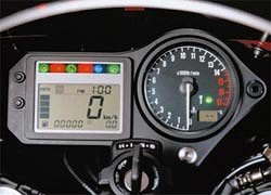 "><br /><b>600F Instruments</b></tr> <p></TD></table> <p>Like many other 2001 Honda models, the 600 receives a new, thin, light instrument panel, featuring several functions, including clock, engine temperature, and remaining fuel.</p> <p>A lighter, yet more powerful, battery is another detail refinement to the CBR600F4.</p> <p>The ""sport"" model introduced in Europe includes even more ""aggressive"" styling, particularly at the rear of the bike.  The black aluminum frame is evident in the photograph.  While the standard model weighs 374 pounds (slightly lighter than the 2000), the sport model is approximately two pounds lighter still.</p> <p>The 2001 VTR1000 Super Hawk has several refinements, as well.  With slightly improved wind protection, along with higher and more comfortable handlebars, the Super Hawk has received (finally) a larger fuel tank (approximately 20 percent more fuel) to allow greater range of travel.  Expect minor engine refinements, including improved carburetion and ignition, to appear in the 2001 Super Hawk, as well.</p> <table border=0 align=LEFT> <tr> <td align=CENTER><img src="