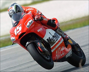 ><br /><b>Sete Gibernau aboard the 2006 Desmosedici<br /> GP6 at Sepang on Wednesday</div> <p>Capirossi enjoyed scattered success last year, including two wins, but wasn&#8217;t consistently competitive with the front-runners.  For 2006, the diminutive Italian will be back, teamed with former Honda hotshoe Sete Gibernau.</p> <p>A few months ago when Gibernau first announced his move to Ducati, <a href=