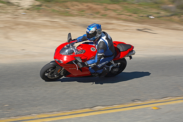 The guy on the BMW R1200 was buzzing my new Ducati 848 test bike pretty