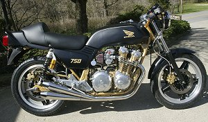 REAL cafe racers were fairingless. Very nice though – I wouldn't mind a tricked up CB750 myself. Larry