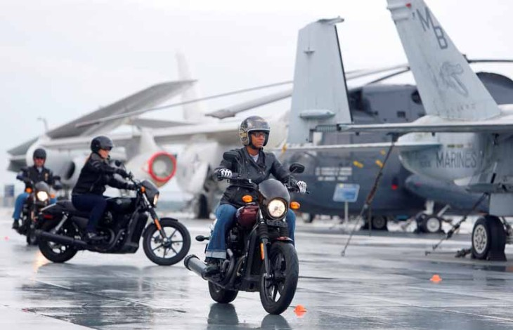 Tamika Whitfield, member of the U.S. Air Force, from Charleston, rides the H-D Street 500 aboard the USS Yorktown Wednesday, May 6, 2015, in Mt. Pleasant, S.C., as Harley-Davidson announced it is offering free Riding Academy to all current and former U.S. Military.  (Mic Smith/AP Images for Harley-Davidson)